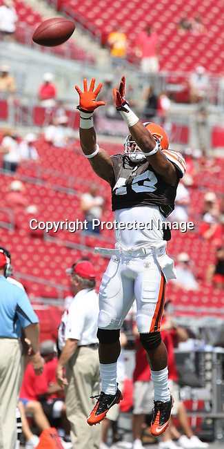 Cleveland Browns safety T.J. Ward catches a pass during pre-game warm-ups as the Browns played the Buccaneers in the opening NFL regular season game Sunday, Sept. 12, 2010 in Tampa,Fla. (AP Photo/Margaret Bowles)