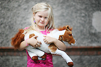 4/8/2010. Kayla Kenny aged 5 from Gorey is pictured in the stables of the Failte Ireland RDS Horse Show. Picture James Horan/Collins Photos