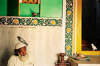 Hitec city, Hyderabad, India, March 2002.Mohammad Habib Khan, a devout muslem, enjoys a moment of peace in Jilani Baba Khadrik Dargah (mausoleum).