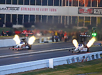 May 13, 2016; Commerce, GA, USA; NHRA top fuel driver Steve Torrence (left) races alongside Richie Crampton during qualifying for the Southern Nationals at Atlanta Dragway. Mandatory Credit: Mark J. Rebilas-USA TODAY Sports