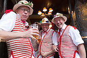 London, UK. 10 May 2014. Pictured: Morris Dancers from Thaxted during a pitstop in a Pub. Morris Dance groups from all over England gathered in London and performed for the public during the Westminster Morris Men Day of Dance.