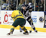 SIOUX FALLS, SD - JANUARY 17:  Ryan Schwalbe #23 from the Sioux Falls Stampede controls the puck as Neal Pionk #5 from the Sioux City Musketeers defends in the first period Friday night at the Sioux Falls Arena. (Photo by Dave Eggen/Inertia)