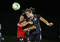Brittany Bock #5 of the Washington Freedom heads away from Carolyn Blank #14 of the Atlanta Beat during a WPS match at Maryland Soccerplex on September 11 2010, in Boyds, Maryland. Freedom won 1-0.