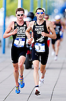 08 AUG 2010 - LONDON, GBR - Stuart Hayes leads Will Clarke during the Elite Mens race at the  2010 Challenger World London Triathlon .(PHOTO (C) NIGEL FARROW)