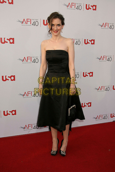 WINONA RYDER.35th AFI Life Achievement Award Honoring Al Pacino held at the Kodak Theatre, Hollywood, California, USA..June 7th, 2007.full length black dress purse bag strapless.CAP/ADM/RE.©Russ Elliot/AdMedia/Capital Pictures