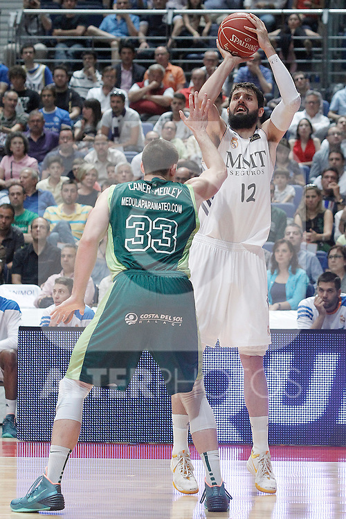 Real Madrid's Nikola Mirotic (r) and Unicaja's Nik Caner-Medley during Liga Endesa ACB Semifinal match.June 6,2014. (ALTERPHOTOS/Acero)