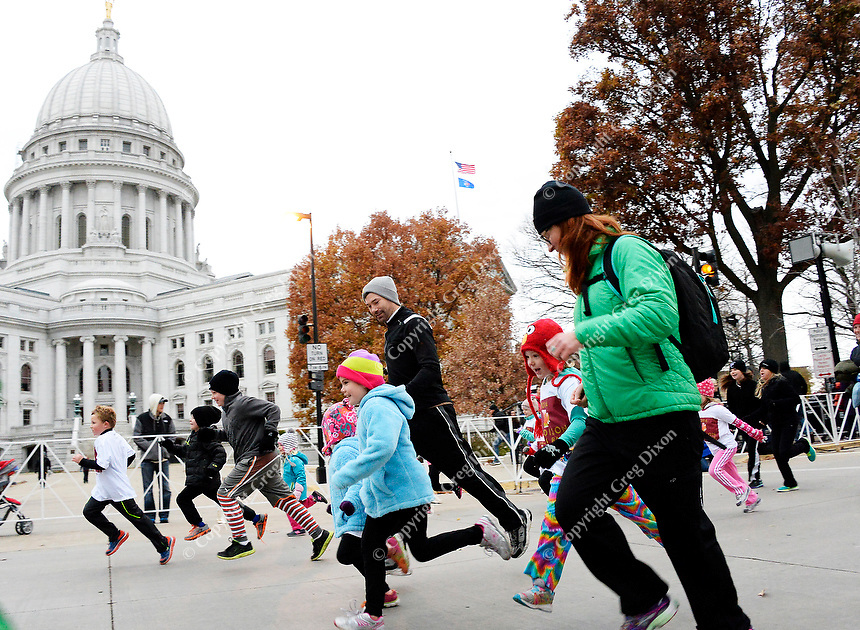 Kids race around the Capital Square during the Kid Race at the Madison Marathon on Sunday in Madison