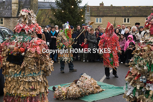 Marshfield Mummers, Boxing Day performance, Gloucestershire, England. 2006. Littel Man John lies slain on the floor by King William with Spear. Father Christmas in red.