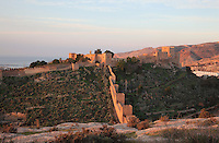 The Jairan Wall in the Hoya ravine, which continues to the San Cristobal Hill, built under King Jairan, 1012-28, in the Alcazaba, a 10th century fortified enclosure and royal residence in Almeria, Andalusia, Southern Spain. The Alcazaba itself was begun in 955 by Rahman III and completed by Hayran, Taifa king of Almeria, in the 11th century. It was later added to by the Catholic monarchs. Picture by Manuel Cohen