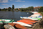 Colourful rowing boats on the Meare boating lake, Thorpeness, Suffolk, England