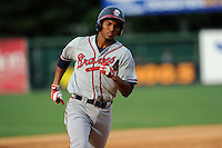 Third baseman Carlos Franco (11) of the Rome Braves trots around the bases after hitting a home run in a game against the Greenville Drive on Sunday, August 3, 2014, at Fluor Field at the West End in Greenville, South Carolina. Rome won, 4-2. (Tom Priddy/Four Seam Images)