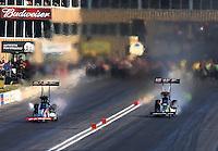 Jul. 20, 2013; Morrison, CO, USA: NHRA top fuel dragster driver Steve Torrence (left) races alongside Terry McMillen during qualifying for the Mile High Nationals at Bandimere Speedway. Mandatory Credit: Mark J. Rebilas-