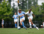 Heather O'Reilly (l), of UNC, holds off UAB's Laura Richards (r) on Sunday September 18th, 2005 at Duke University's Koskinen Stadium in Durham, North Carolina. The University of North Carolina Tarheels defeated the University of Alabama-Birmingham Blazers 4-0 during the Duke adidas Classic soccer tournament.