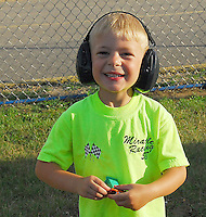 The cars are quite loud at the race, and the officials wear headsets for ear protection. Here, Braxton Potter readies his equipment for the race at Dells Raceway Park on August 12, 2008.