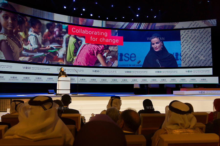 Qatar, Doha, Qatar National Convention Centre <br /> Opening speech of the World Innovation Submit for Education 2012 (WISE): portrait of Sheikha Mozah bint Nasser Al Missned, second of the three wives of Sheikh Hamad bin Khalifa Al Thani, former Emir of the State of Qatar, from 1995 to 2013 and mother of the current emir, Sheikh Tamim bin Hamad Al Thani. <br /> Founder of the Qatar foundation for education founded in 1996, she presides at the Foundation's annual convention every year. Named UNESCO Special Envoy for Basic &amp; Higher Education in 2013, she oversees all Qatari reforms related to education and the Family Law adopted in 2006 in Qatar. <br /> Qatar is one of the Arab peninsular emirates, on the Persian Gulf shoreline. Bordered by Saudi Arabia, Qatar's economy relies on oil and gas. Being the world's fourth-largest gas exporter, gas remains the major driver of Qatar's economy. The emirate is governed by Sheikh Tamim bin Hamad Al Thani who became at the age of 33 Emir of Qatar on 25 June 25th, 2013 after his father's abdication. He is the youngest emir at the head of an Arab State.<br /> On June 5th, 2017, Saudi Arabia, the United Arab Emirates, Egypt, Bahrain, Yemen, Libya, Mauritania, the Maldives, and Mauritius broke off diplomatic relations with Qatar, accusing the emirate of supporting several terrorist groups. As its Gulf neighbours enforced the closure of all land, air and sea borders to Qatar, the country is quarantined.<br /> <br /><br />Qatar, Doha, Centre national des congr&egrave;s du Qatar. <br />Discours d'ouverture du World Innovation Submit for Education 2012 (WISE) : portrait de cheikha Moza Bint Nasser Al-Misnad, seconde des trois &eacute;pouses de l'&eacute;mir Hamad Ben Khalifa Al-Thani, l&rsquo;&eacute;mir du Qatar de 1995 &agrave; 2013, et m&egrave;re de l'actuel &eacute;mir, leur fils cheikh Tamim ben Hamad Al Thani. <br />Fondatrice de la fondation du Qatar pour l'&eacute;ducation cr&eacute;&eacute;e en 1996, elle pr&eacute;side c