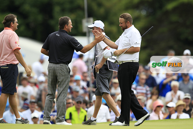 Graeme McDowell (NIR) and Shane Lowry (IRL) finish on the 9th green during Friday's Round 2 of the 2014 Irish Open held at Fota Island Resort, Cork, Ireland. 20th June 2014.<br /> Picture: Eoin Clarke www.golffile.ie