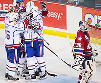 April 28, 2007; Hamilton, ON, CAN; Hamilton Bulldogs celebrate the goal by defenceman (2) Ryan O'Byrne as Rochester Americans goalie (30) Craig Anderson skates past in the third period of game six in the AHL north division semifinal at Copps Coliseum. The Bulldogs won 6-2 and eliminated the Americans from the playoffs. Mandatory Credit: Ron Scheffler, Special to the Spectator. (File number RRSA8335).