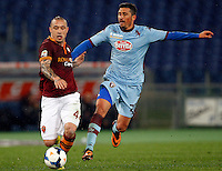 Calcio, Serie A: Roma vs Torino. Roma, stadio Olimpico, 25 marzo 2014.<br /> AS Roma midfielder Radja Nainggolan, of Belgium, is challenged by Torino midfielder Giuseppe Vives, right, during the Italian Serie A football match between AS Roma and Torino at Rome's Olympic stadium, 25 March 2014.<br /> UPDATE IMAGES PRESS/Riccardo De Luca