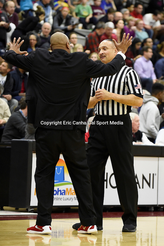 Friday, January 29, 2016: Cornell Big Red head coach Bill Courtney talks to an official during the NCAA basketball game between the Cornell Big Red and the Harvard Crimson held at the Lavietes Pavilion in Boston, Massachusetts. Cornell defeats Harvard 65-77. Eric Canha/CSM