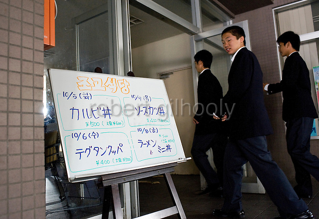 Students enter the dining area of Tokyo Korean High School in Tokyo, Japan on Thursday 07 October, 2010..Photographer: Robert Gilhooly