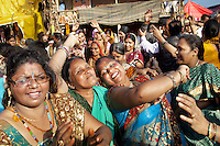 India. Uttar Pradesh state. Allahabad. Maha Kumbh Mela. Women and men dance inside the courtyard of a guru's ward. The Kumbh Mela, believed to be the largest religious gathering is held every 12 years on the banks of the 'Sangam'- the confluence of the holy rivers Ganga, Yamuna and the mythical Saraswati. The Maha (great) Kumbh Mela, which comes after 12 Purna Kumbh Mela, or 144 years, is always held at Allahabad. Uttar Pradesh (abbreviated U.P.) is a state located in northern India. 17.02.13 © 2013 Didier Ruef