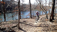 NWA Democrat-Gazette/FLIP PUTTHOFF <br /> The soft-surface loop trail around Lake Fayetteville is ideal for riders new to mountain biking but offers a nice ride for experienced riders like Brannon Pack, executive director of the Ozark Off Road Cyclists. Pack rides a section on Feb. 3 2017 that runs along the south side of the lake. Ozark Off Road Cyclists and Progressive Trail Design have improved the trail over several years.