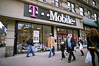 A T-Mobile store in the Upper West Side neighborhood in New York on Sunday, November 27, 2011. The Dept. of Justice has filed a civil antitrust lawsuit against the merger of the two companies, AT&T and T-Mobile, contending that it would lead to higher prices. The Federal Communications Commission Chairman Julius Genachowski is recommending that the FCC refer the  lawsuit against the merger to an administrative law judge.  (© Richard B. Levine)