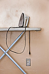 USA, Florida, St. Pete Beach, Iron on ironing board against wall