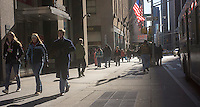Pedestrians on Sixth Avenue in Midtown Manhattan in New York on Monday, February 18, 2013. (© Richard B. Levine)