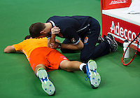 29-01-2014,Czech Republic, Ostrava,  Cez Arena, Davis-cup Czech Republic vs Netherlands, practice, Robin Haase(NED) gets fysio treatment from Edwin Visser(NED)<br /> Photo: Henk Koster