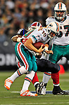 7 December 2008: Miami Dolphins' quarterback Chad Pennington is tackled by Buffalo Bills defensive tackle Spencer Johnson during the first regular season NFL game ever played in Canada. The Dolphins defeated the Bills 16-3 at the Rogers Centre in Toronto, Ontario. ..Mandatory Photo Credit: Ed Wolfstein Photo