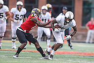 College Park, MD - October 1, 2016: Purdue Boilermakers wide receiver DeAngelo Yancey (7) is tackled by Maryland Terrapins defensive back JC Jackson (7) during game between Purdue and Maryland at  Capital One Field at Maryland Stadium in College Park, MD.  (Photo by Elliott Brown/Media Images International)