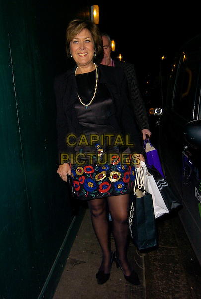LYNDA BELLINGHAM.Spotted outside The Ivy restaurant, London, England,.December 15th 2007..full length Linda black blue red patterned trim dress shopping bags.CAP/CAN.©Can Nguyen/Capital Pictures
