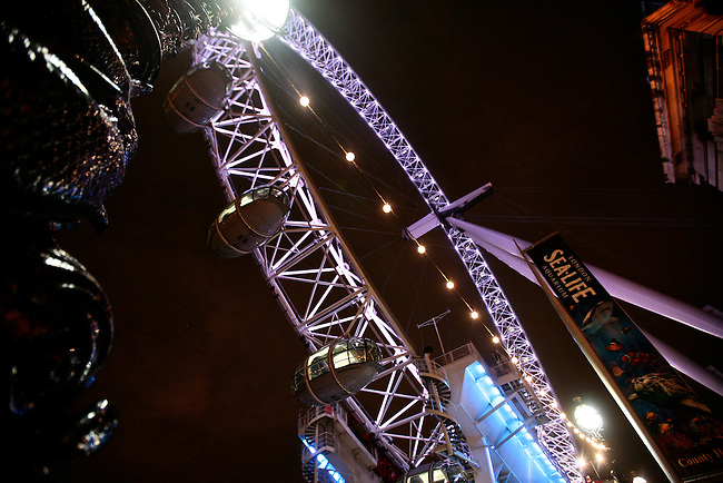 The Millennium Wheel is illuminated against the night sky in London, England. May 16, 2009.