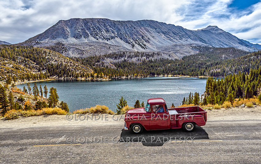 1955 Red Chevy Truck cruising by a Sierra Lake, California
