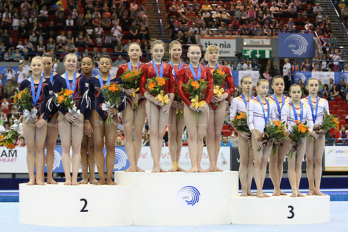 Russian team at the first place, Great Britain team second place, Romania third place on the podium during the senior women  team finals at the European Artistic Gymnastics Championship at the National Indoor Arena in Birmingham, UK on May 1, 2010.