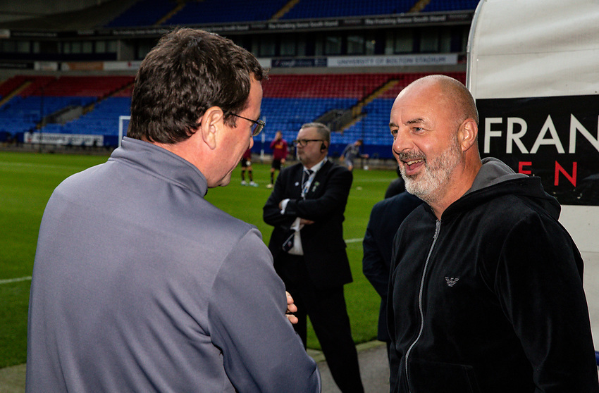 Bolton Wanderers' manager Keith Hill (right) chats with Bradford City's manager Gary Bowyer before the match<br /> <br /> Photographer Andrew Kearns/CameraSport<br /> <br /> EFL Leasing.com Trophy - Northern Section - Group F - Bolton Wanderers v Bradford City -  Tuesday 3rd September 2019 - University of Bolton Stadium - Bolton<br />  <br /> World Copyright © 2018 CameraSport. All rights reserved. 43 Linden Ave. Countesthorpe. Leicester. England. LE8 5PG - Tel: +44 (0) 116 277 4147 - admin@camerasport.com - www.camerasport.com