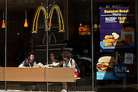 07/23/2015. Costumers visit a McDonald's restaurant in the Greenwich Village neighbor in New York City. The state fast food workers' wages will eventually rise to $15 (£9.60) an hour. Kena Betancur/VIEWpress