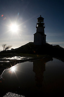 The Cape Disappointment Lighthouse on the Long Beach peninusla in Washington State is silhouetted Saturday Feb. 7, 2009.