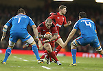 Wales prop Paul James takes on Italian pair Michele Rizzo and Quintin Geldenhuys.<br /> RBS 6 Nations 2014<br /> Wales v Italy<br /> Millennium Stadium<br /> 01.02.14<br /> <br /> &copy;Steve Pope-SPORTINGWALES