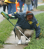 """Manassas, VA - October 10, 2002 --  FBI agent searches with a metal detector for clues the morning after a Gaithersburg man was murdered while pumping gas at a Sunoco station.  It is still unclear if the man is another victim of the """"Beltway Sniper"""".<br /> Credit: Ron Sachs / CNP<br /> (RESTRICTION: NO New York or New Jersey Newspapers or newspapers within a 75 mile radius of New York City)"""