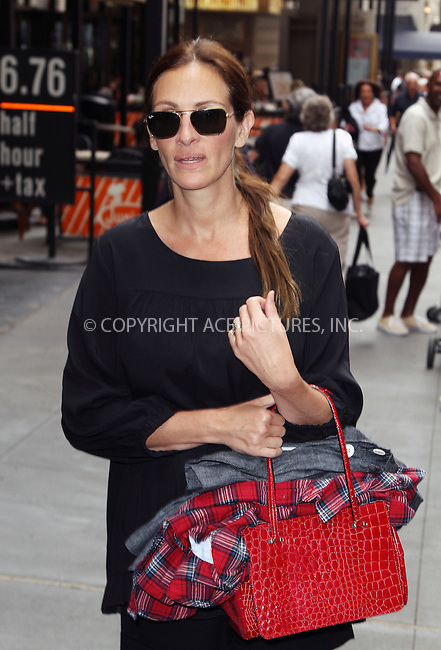 WWW.ACEPIXS.COM<br /> <br /> June 26 2013, New York City<br /> <br /> Actress Julia Roberts arriving at the Minskoff Theatre to see a performance of 'The Lion King' on June 26 2013 in New York City<br /> <br /> By Line: Zelig Shaul/ACE Pictures<br /> <br /> <br /> ACE Pictures, Inc.<br /> tel: 646 769 0430<br /> Email: info@acepixs.com<br /> www.acepixs.com