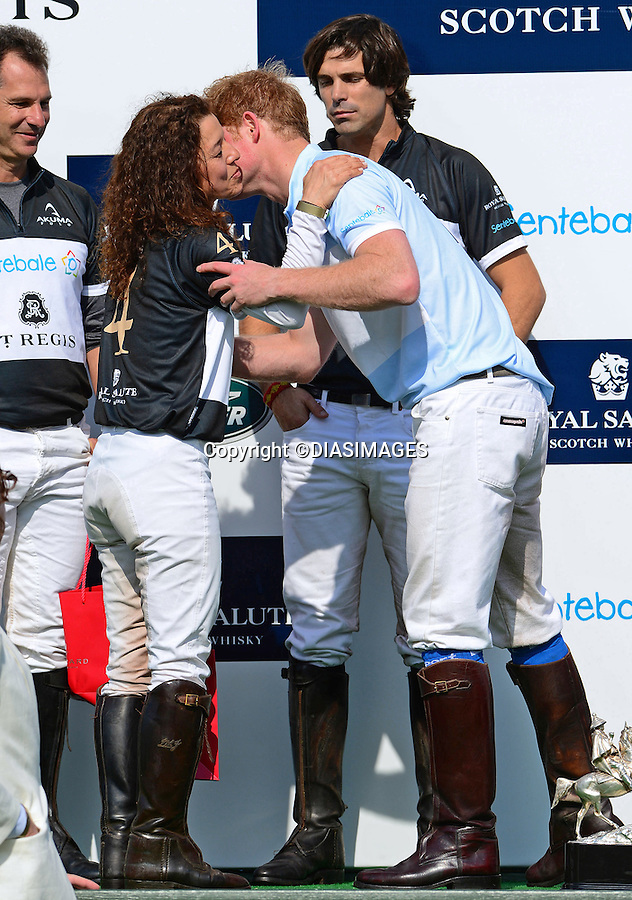 "PRINCE HARRY KISSES JONES.during the presentation ceremony for the Sentabale Charity Polo Match at the Greenwich Polo Club, Conneticut_15/05/2013.Prince Harry is on a week long USA visit the includes Washington, Denver, Colorado Springs, New Jersey, New York and Conneticut..Mandatory credit photo:©DIASIMAGES..NO UK USE UNTIL 11/06/2013.(Failure to credit will incur a surcharge of 100% of reproduction fees)..**ALL FEES PAYABLE TO: ""NEWSPIX  INTERNATIONAL""**..Newspix International, 31 Chinnery Hill, Bishop's Stortford, ENGLAND CM23 3PS.Tel:+441279 324672.Fax: +441279656877.Mobile:  07775681153.e-mail: info@newspixinternational.co.uk"