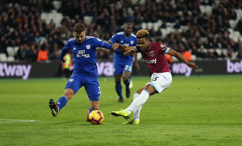 West Ham United's Grady Diangana with a second half shot under pressure from Cardiff City's Joe Bennett<br /> <br /> Photographer Rob Newell/CameraSport<br /> <br /> The Premier League - West Ham United v Cardiff City - Tuesday 4th December 2018 - London Stadium - London<br /> <br /> World Copyright © 2018 CameraSport. All rights reserved. 43 Linden Ave. Countesthorpe. Leicester. England. LE8 5PG - Tel: +44 (0) 116 277 4147 - admin@camerasport.com - www.camerasport.com