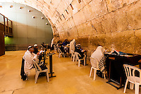 Hassidic Jews in the Prayer Hall, a covered section of the Western Wall Plaza, Western Wall (Wailing Wall), Old City, Jerusalem, Israel.