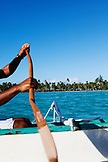 FRENCH POLYNESIA, Tahaa Island. Roe, riding his outrigger canoe between Tahaa Island and Vahine Island.