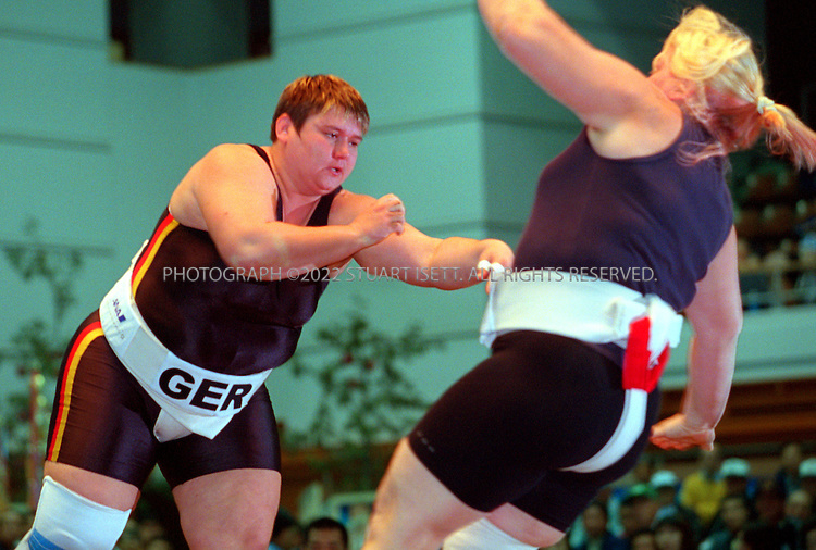 10/26/2001--Hirosaki, Aomori Prefecture, Japan..Sandra Koppemn Germany  (left) at the World internationl sumo tournament...All photographs ©2003 Stuart Isett.All rights reserved.This image may not be reproduced without expressed written permission from Stuart Isett.