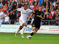 Saturday, 20 October 2012<br /> Pictured L-R: Jonathan de Guzman of Swansea marked by James McArthy of Wigan<br /> Re: Barclays Premier League, Swansea City FC v Wigan Athletic at the Liberty Stadium, south Wales.