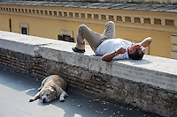 Man and dog take an afternoon break, Rome, Italy