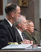 """United States Navy Admiral John M. Richardson, Chief Of Naval Operations, left, US Secretary of The Navy Richard V. Spencer, center, and US Marine Corps General Robert B. Neller, Commandant of The US Marine Corps, right, testify before the US Senate Committee on Armed Services """"on the posture of the Department of the Navy in review of the Defense Authorization Request for Fiscal Year 2019 and the Future Years Defense Program"""" on Thursday, April 19, 2018.<br /> Credit: Ron Sachs / CNP"""